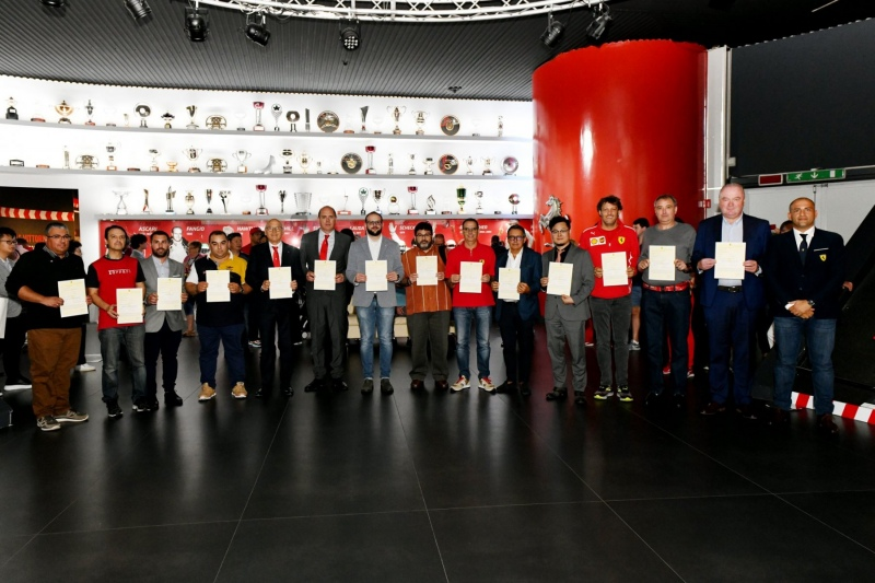 Photo Group of the new 14 Clubes at the Museo Ferrari Trophy Room